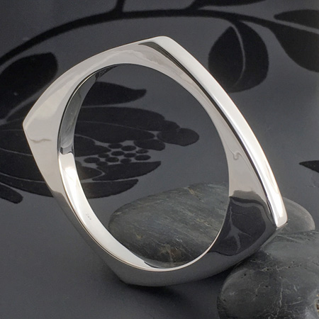Modern pointed sterling silver bangle