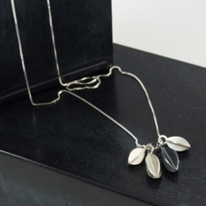 silver necklace with pods