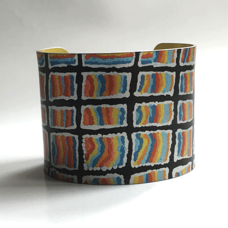 Yumari wide Australian cuff bracelet in vibrant colours. Aboriginal artwork transferred onto contemporary Australian jewellery design. Front view.
