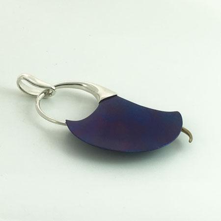 Open calla lily silver pendant back.