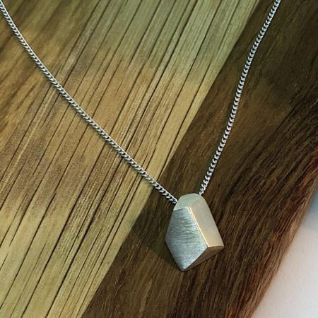 Graphic silver pendant