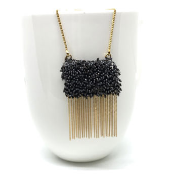 Black beaded gold bib necklace
