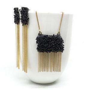 Black beaded gold bib necklace